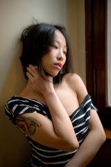 Beautiful sensual asian woman posing thoughtful