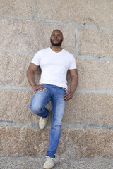 black man leaning against the wall