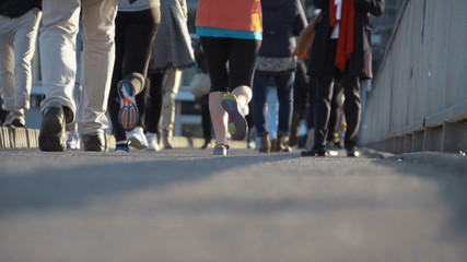 Pedestrians and joggers in slow motion in the city. Find similar