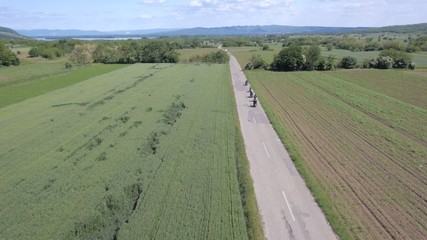 Aerial view on group of bikers riding on the rural area road
