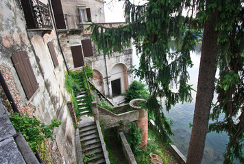 Beauty building on the bluff above the river in Italy