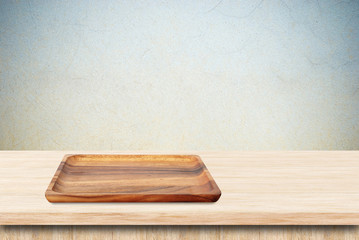 Blank wood tray on table background