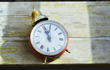 Vintage clock on the old table