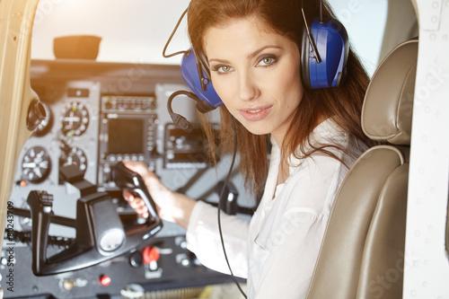 Leinwandbild Motiv woman in cockpit