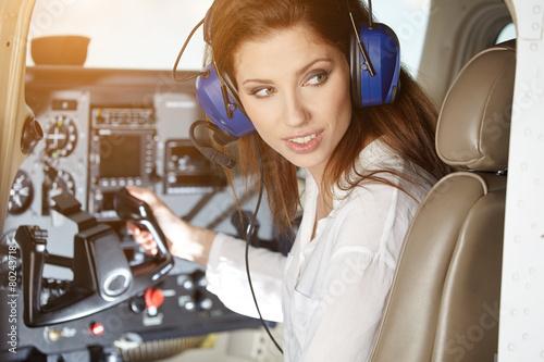 Leinwanddruck Bild woman in cockpit