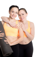 Portrait of sporty beautiful girls with yoga mat