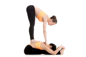 Yoga with partner, seated and standing forward bend