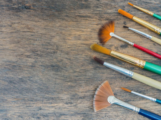 Set of paint brush on wooden  table