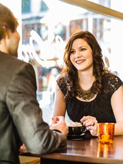 Couple enjoying cappuccino at the restaurant