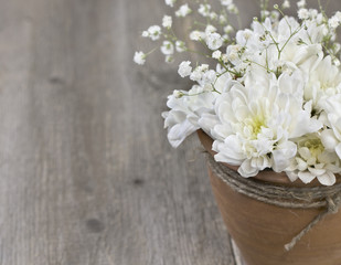 bouquet of white chrysanthemums in a ceramic pot