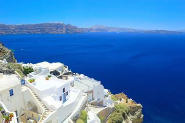 View from scenic village Oia into volcanic caldera, Santorini
