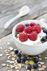cup of muesli with raspberries and blueberries