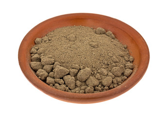 Comfrey Root Powder In Bowl Side View