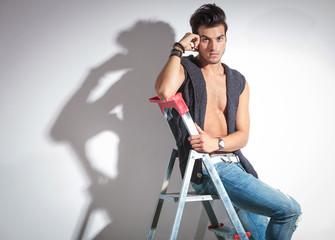 fashion man resting on a ladder