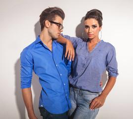 Gorgeous fashion woman leaning one arm on her boyfriend.