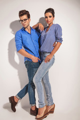 Full body picture of a young fashion couple