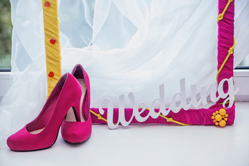 decorative frame, women's shoes and the word Wedding