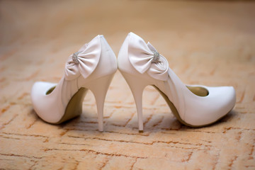 White shoes of the bride close-up