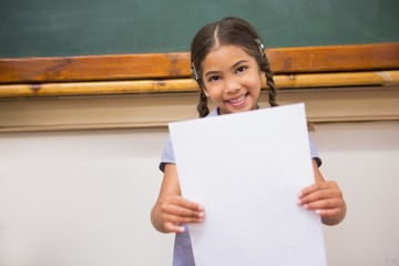 Smiling pupil showing paper