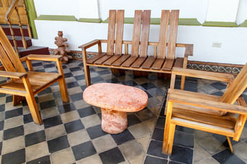 wood chairs around a marble table