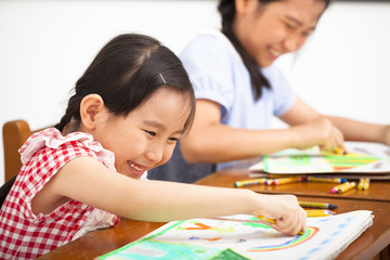 happy children drawing in the classroom