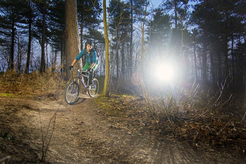 Mountain biker on a gravel trail at sunset