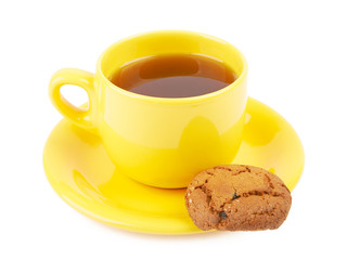 Cup of tea and chocolate cookies on a white background isolated