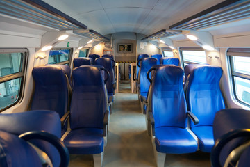 Interior of  car of  intercity train with sedentary places