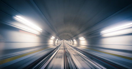 Subway tunnel and blurred light trails