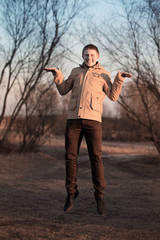 Young man jumping for joy outdoor