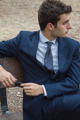 Young businessman sitting on a bench