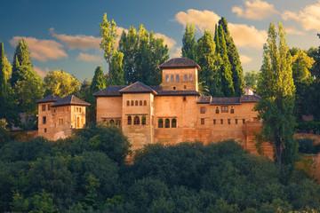 Alhambra de Granada. Exterior view of Partal area at sunset.