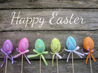 Easter card with eggs on wooden background