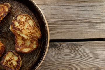 Pan with pancakes left rustic table