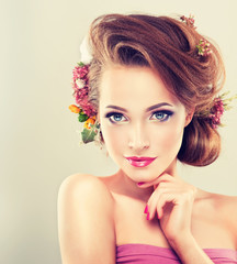 Spring girl with flowers in her hair and fashion makeup