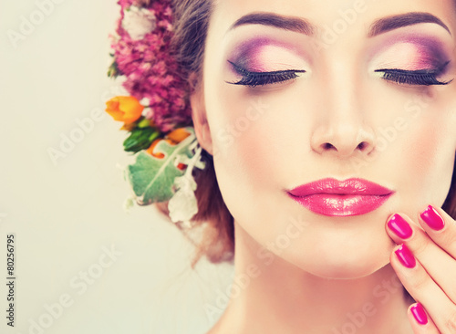 Girl with delicate  flowers in hair and fashion  fuchsia nail Photo by edwardderule