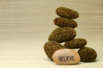 believe stone with moss covered rocks
