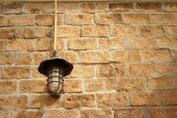 Wall lamp on a rocks background at the park