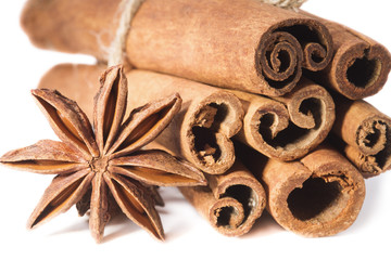 Anise seeds and dried cinnamon, close-up