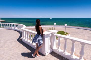 Young woman enjoying the sea view