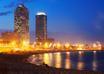 Beach and towers of Port Olimpic in  twilight. Barcelona