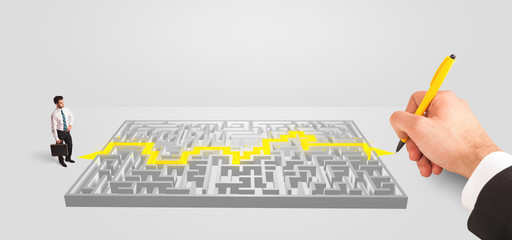 Businessman in front of a maze with solution