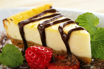 Cheesecake slice and melted chocolate