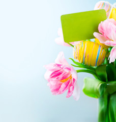 Easter holiday flowers bunch with greeting card. Colorful tulips