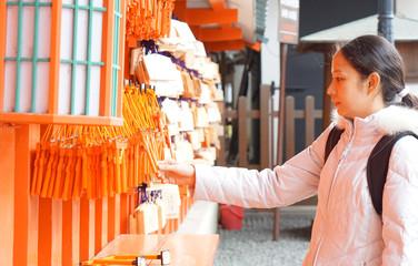 girl with ema in Japanese shrine
