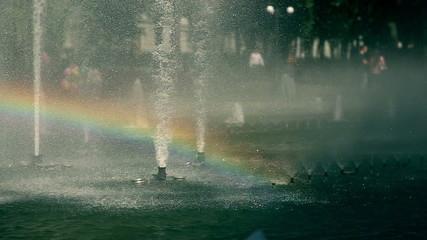 The rainbow inside of park fountane. Slowmotion.