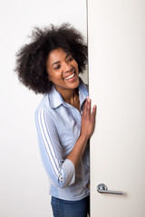 young woman entering a room