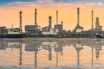 Petrochemical plant at sunrise with water relfextion