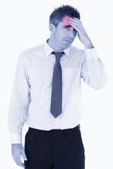 Portrait of a sad business manager with his hand on his forehead