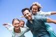 Leinwandbild Motiv Happy parents with their children